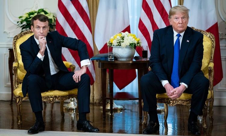 Những rạn nứt giữa Tổng thống Pháp Emmanuel Macron (trái) và Tổng thống Mỹ Donald Trump tại cuộc gặp trước thềm hội nghị thượng đỉnh NATO ở London, Anh, ngày 3/12.(Ảnh: NYTimes)