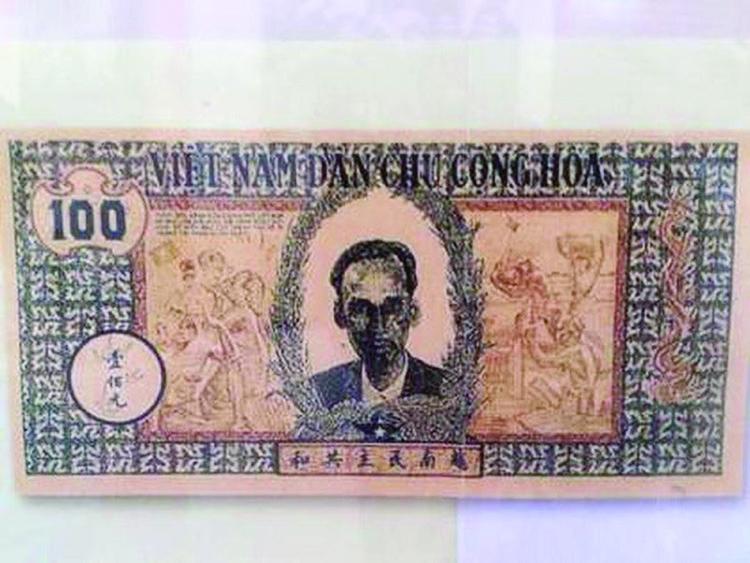 Tờ giấy bạc 100 đồng ra đời đại diện cho nền độc lập, tự do của Tổ quốc, chủ quyền thiêng liêng của quốc gia in hình Chủ tịch Hồ Chí Minh (ảnh: tư liệu)