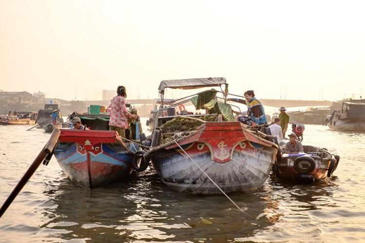 Ở Cần Thơ, anh đã có những tấm ảnh ưng ý nhất khi dõi theo cuộc sống sông nước của người dân nơi đây.