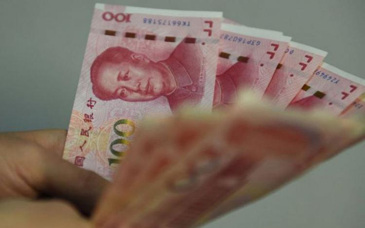 Trung Quốc đang tìm cách quốc tế hóa đồng nhân dân tệ bằng cách tăng việc sử dụng nó trong các giao dịch quốc tế. (Ảnh minh họa: BBC)